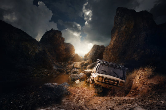 4x4 off road vehicle coming out of a mud hole hazard,mud and water splash in off-road racing on mountain road.