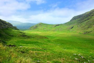 Picturesque green fields of Molls Gap mountain pass along the Ring of Kerry, Ireland