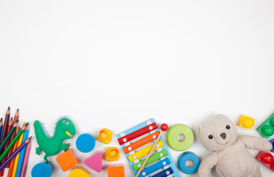 Baby kids toys on white background with copy space for text