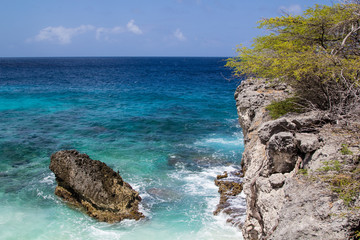 Crystal clear waters, smooth surf  and a rocky coast on ther north shore of the tropical island of Bonaire in the Netherlands Antilles