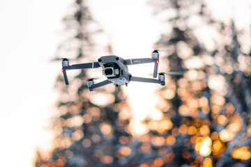 Hovering drone at golden hour
