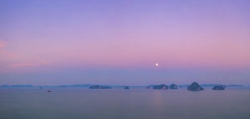 aerial panorama view full moon shine in the morning above archipelago at Tup Kaek beach Krabi Thailand.