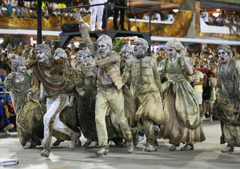 Revellers from the Vila Isabel samba school perform during the second night of the Carnival parade at the Sambadrome in Rio de Janeiro