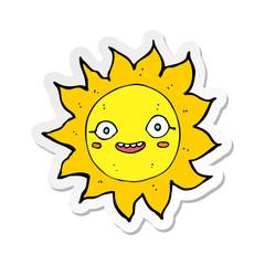 sticker of a cartoon happy sun