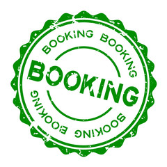 Grunge green booking word round rubber seal stamp on white background