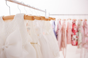 White dresses hung on hangers