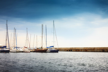 Yachts at the berth in the port. Landscape with boats.