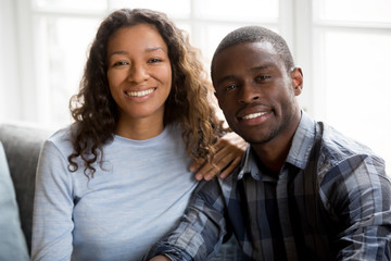 Portrait of happy mixed race couple posing for picture