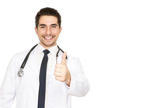 Health rocks! Studio portrait of a handsome cheerful male doctor smiling happily showing thumbs up copyspace on the side