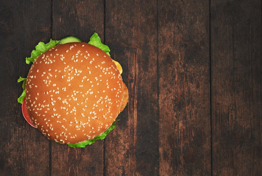 Fresh burger on an old wooden table. Top view