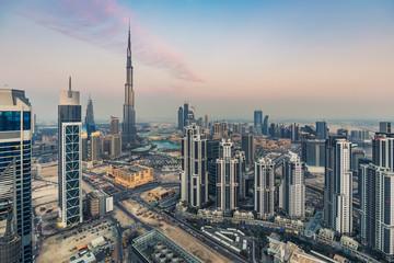 Skyline of a big modern city. Dubai, United Arab Emirates, at sunset. Aerial view.