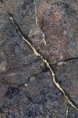 Close up texture of granite walls and rocks in high resolution with cracks and stunning structures