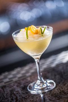 Cocktail drink frozen margarita at barcounter in night club or restaurant