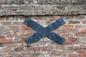 Brick wall with steel support cross