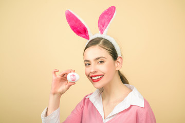 Happy easter. Young woman in rabbit bunny ears. Easter bunny woman, rabbit and girl. Lipstick kiss print on easter egg.