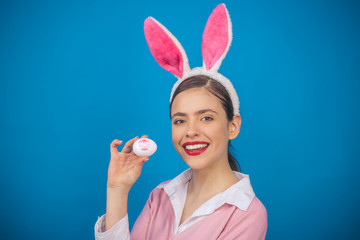 Happy easter. Lips and Easter, Lipstick kiss imprint on easter egg. Young woman in rabbit bunny ears. Portrait of a happy woman in bunny ears. Egg hunt. Beautiful woman in fashion bunny mask.