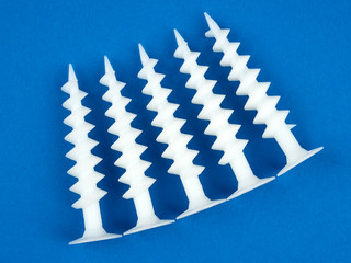 Special dowels for fixing light objects in styrofoam insulation, on blue background