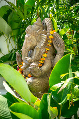 Garland of golden flowers draped around Ganesha