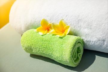 Pretty yellow plumeria flowers on towels