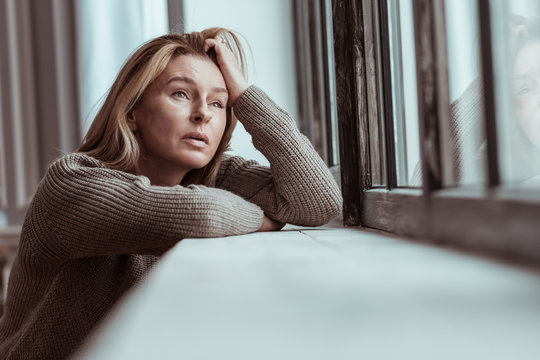 Woman thinking about suicide after personal problems