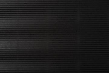 cardboard corrugated pattern background horizontal at black color