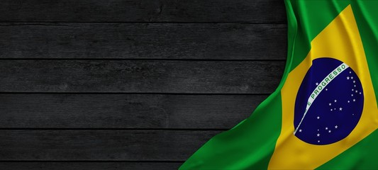 Fototapeten Brasilien Flag of the Brazil, fabric on dark wood.
