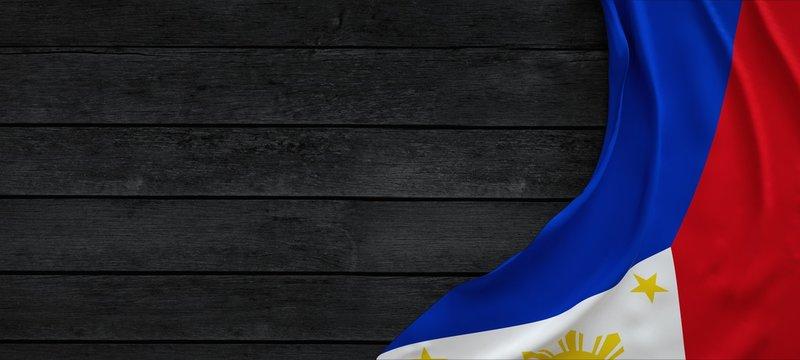Flag of the Philippines, fabric on dark wood.