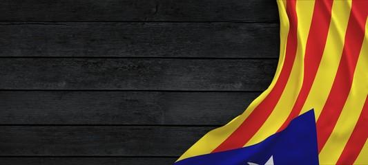 Flag of the Catalonia, fabric on dark wood.