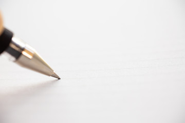 Hand writing letter on white paper background, A pen, Close up & Macro shot, Selective focus, Stationery concept