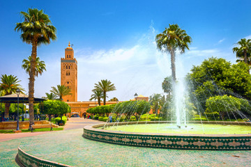 Cityscape with beautiful fountain in park. View of Koutoubia Mosque. Marrakesh, Morocco, North Africa