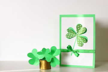 Diy St Patricks Day greeting card made cardboard and paper clovers gray background. Gift idea, decor