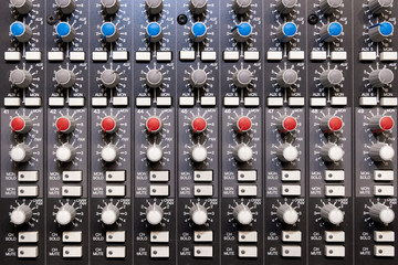Abstract view of Professional audio mixing console with faders and adjusting knobs -Music / radio / TV broadcasting