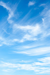 White clouds high in the sky at windy winter day background