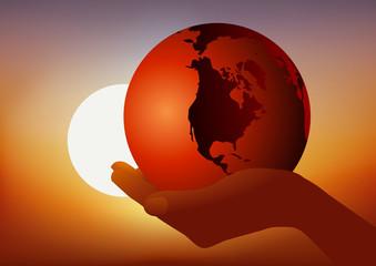 Concept de l'environnement avec une main qui présente symboliquement la terre pour rappeler le danger du réchauffement climatique