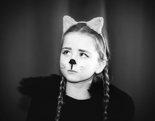 Cute little girl dressed and maked-up like a cat