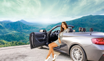 Slim young woman in summer silver car.