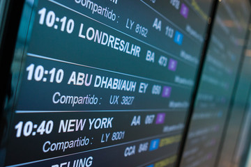 Airport board departures announces the next flights timetable