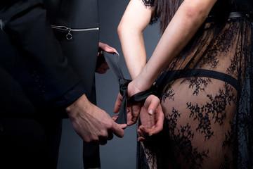 couple tie hands behind back