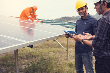 Electrical engineers are installing solar panels. To produce electricity from sunlight.