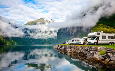 Foto auf Acrylglas Camping Campervan RV vehicles at norwegian camping by a fjord