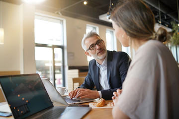 Sales meeting in modern open plan office space