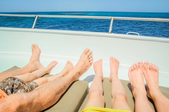 Stylish beautiful legs on a ship yacht in the sea background