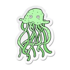 sticker of a cartoon octopus