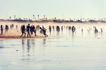 Silhouettes of various people at the beach of Casablanca, Morocco, Africa