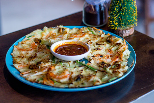 Seafood pancake with shrimp and spring onion and sauce