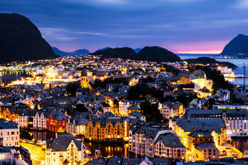 Aerial view of Alesund, Norway at sunset. Blue night sky over famous