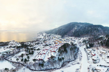 Aerial view of residential area in Molde, Norway during a cloudy day in winter