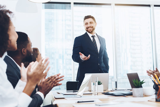 Business team applauding to boss at meeting