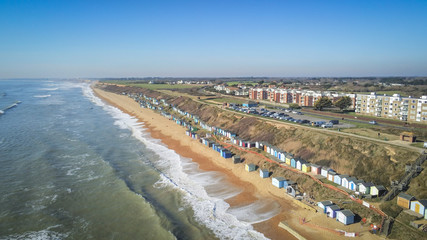 Aerial view over a typical south coast in England with its colorful huts