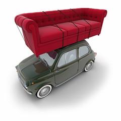 Small retro car carrying a sofa